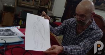 Київських художник Юрій Нікітін малює панно видатних діячів Острозької академії
